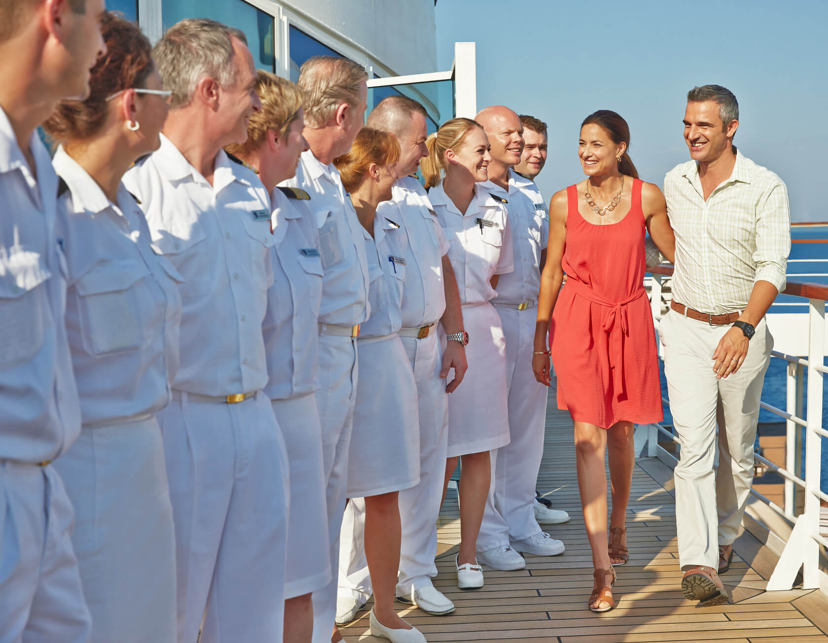 Couple getting greeted by Seabourn Crew