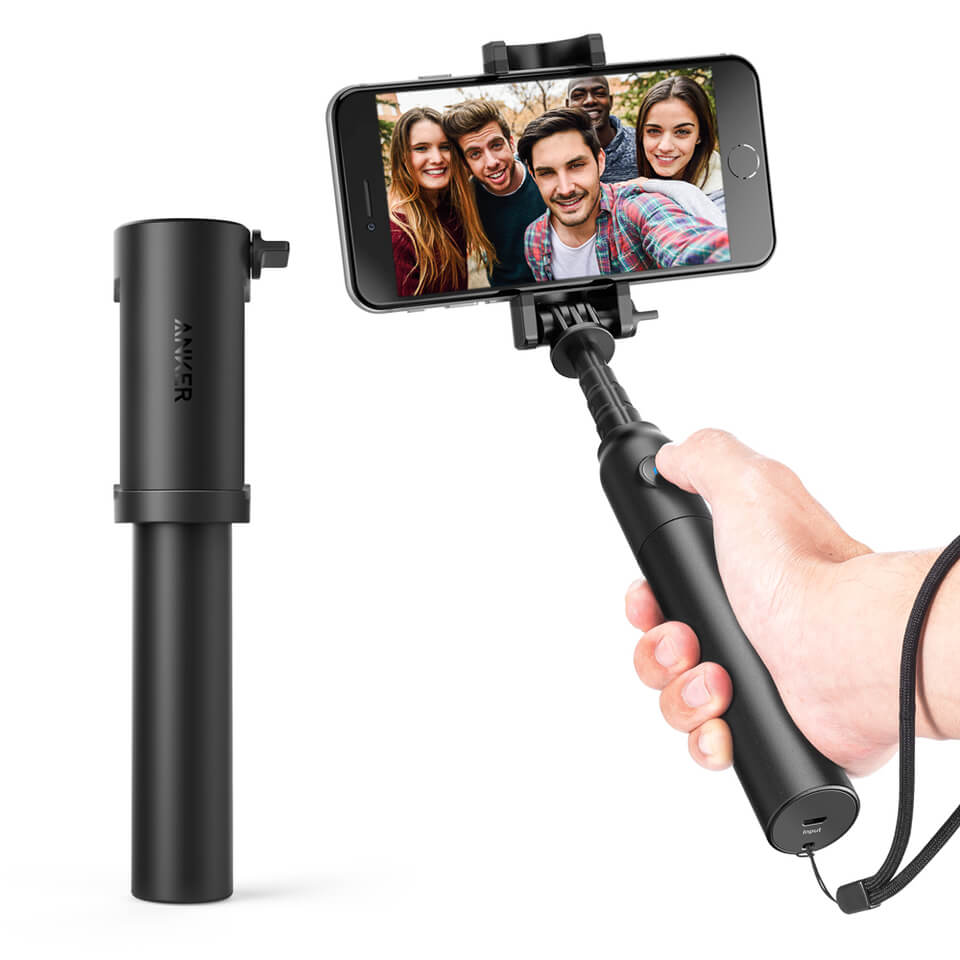 A black small selfie stick with wrist band