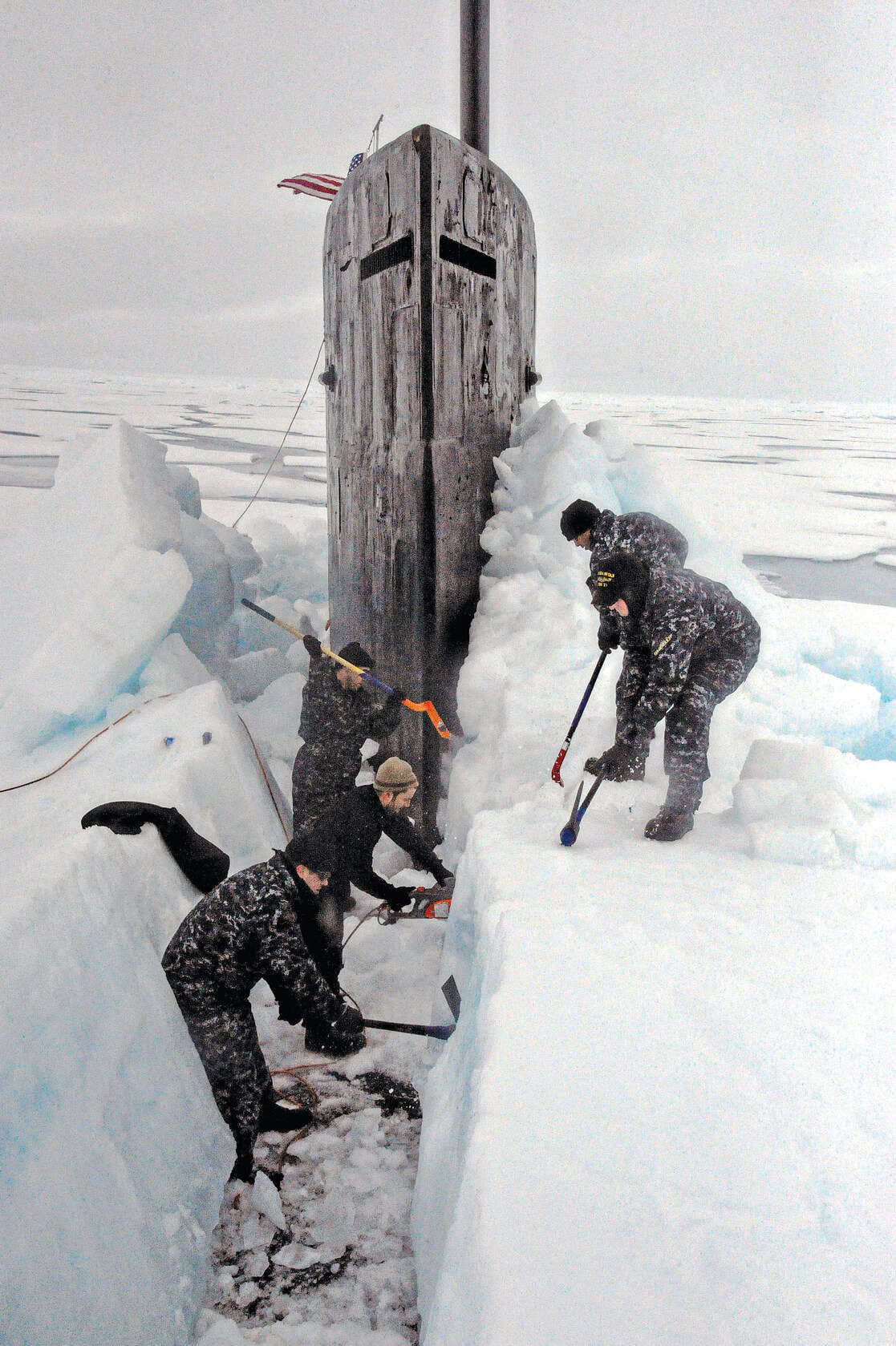 People digging out ice in Alaska